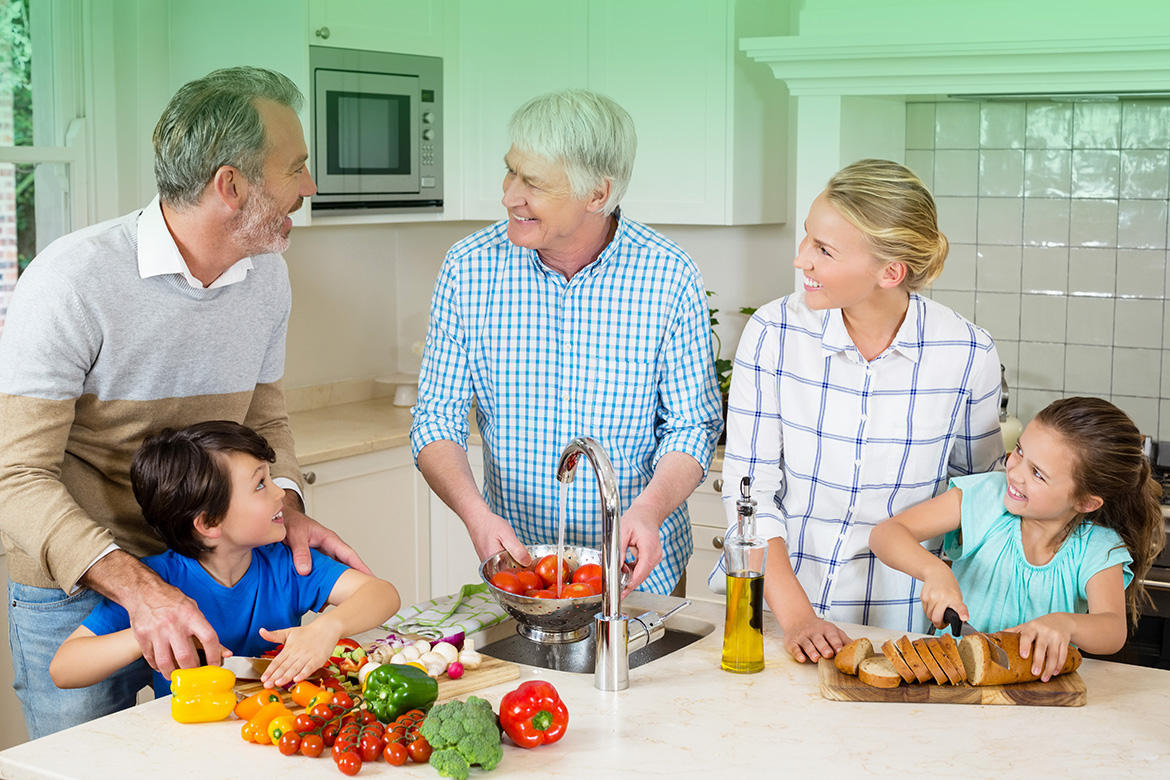senior-man-interacting-with-his-family-while-prepa-37V69CA.jpg